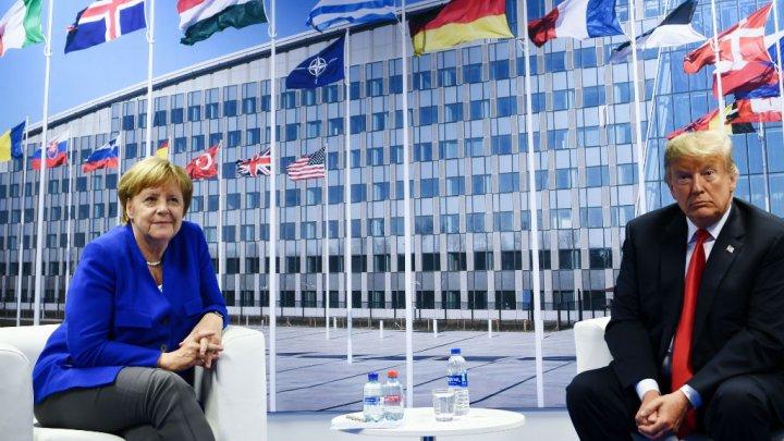 Sommet de l'Otan : Trump et Merkel affichent une unité de façade