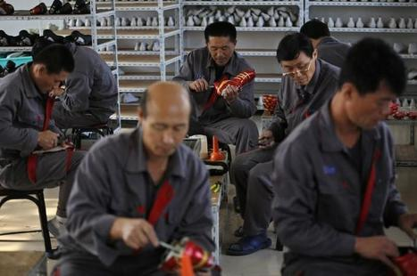 North Korea factories humming with 'Made in China' clothes, traders say